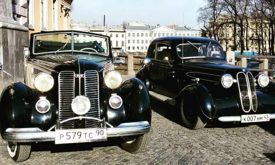 Two retro taxis parked on the streets of St Petersburg, Russia.