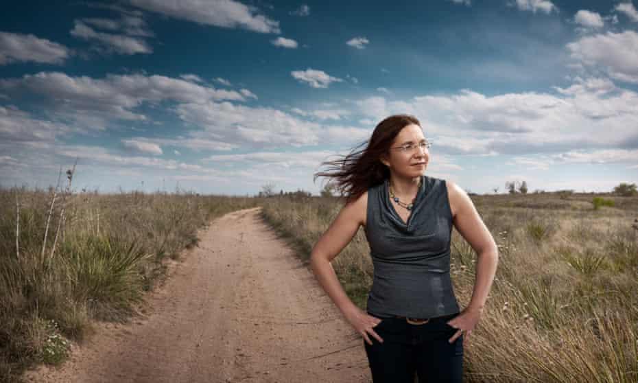 katharine hayhoe standing on a dirt road in lubbock texas