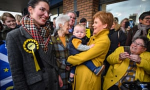 Nicola Sturgeon (holding the baby) campaigning with SNP candidate Catriona MacDonald (left) in Edinburgh South at Blossom Tree Nursery today.