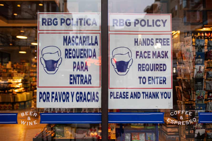 A grocery store displays a sign requiring customers to wear masks on 10 March 2021 in Austin, Texas.