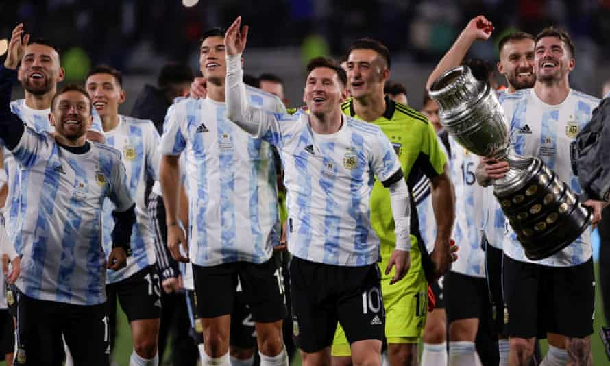 Lionel Messi and his teammates celebrate by displaying  the Copa América trophy at the end of the win over Bolivia.