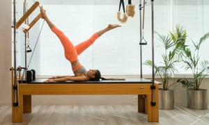 Woman doing reformer fitness exercise