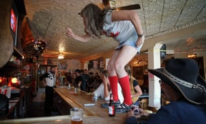 Sourtoe Sue gets up on the bar in The Pit.
