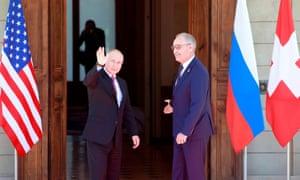Vladimir Putin greets Swiss President Guy Parmelin.
