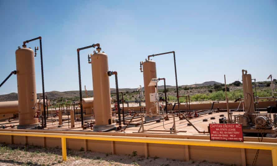 Equipment at a fracking well in the world's largest oil field, straddling the border between Texas and New Mexico.