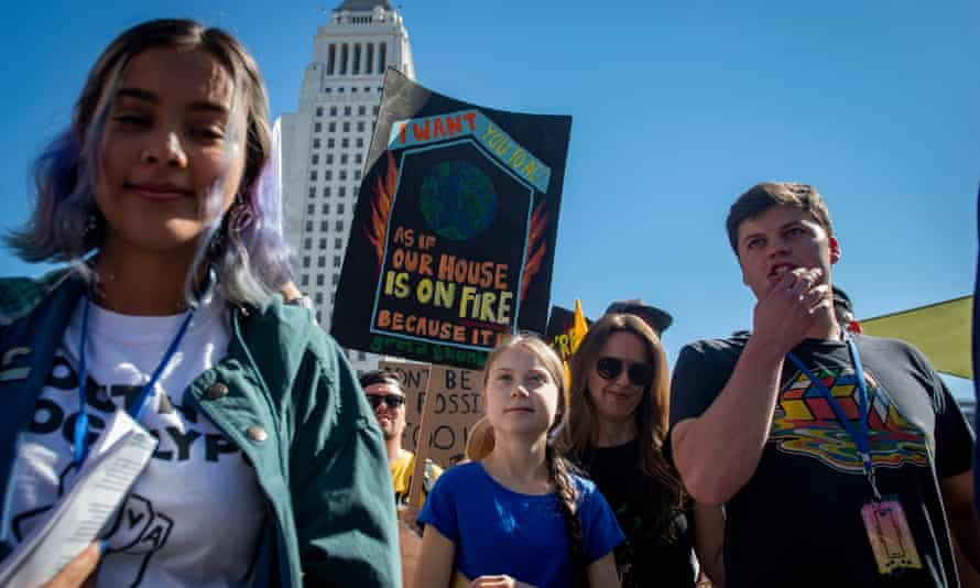 Greta Thunberg marches in front of Los Angeles City Hall at the youth climate strike.