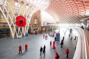 A two-minute silence is observed at King's Cross station in London