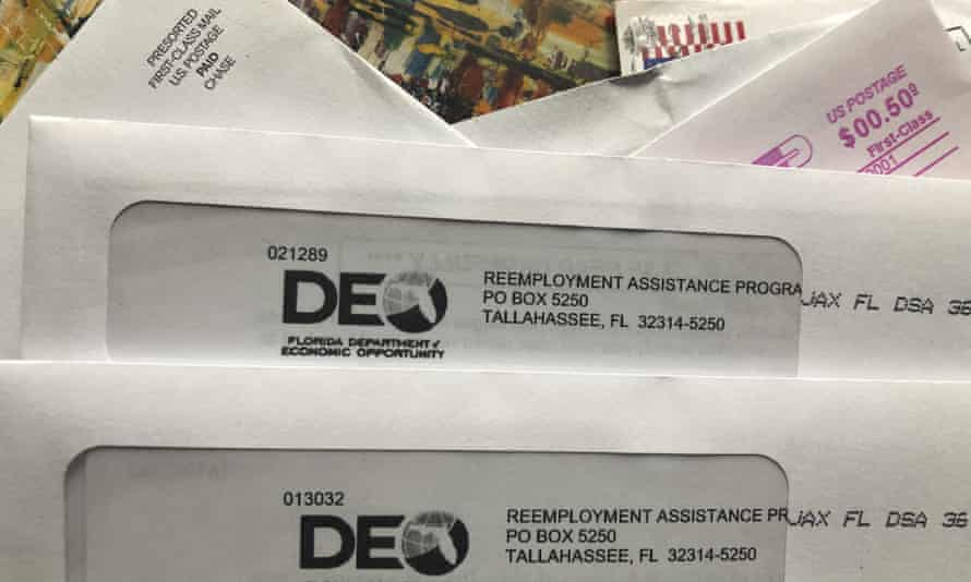 Envelopes from the Florida department of economic opportunity reemployment assistance program are shown, in Surfside, Florida, last year.