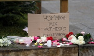 Flowers, candles and a sign reading: 'Tribute to the victims - I am Strasbourg' at the scene of one of the shootings.