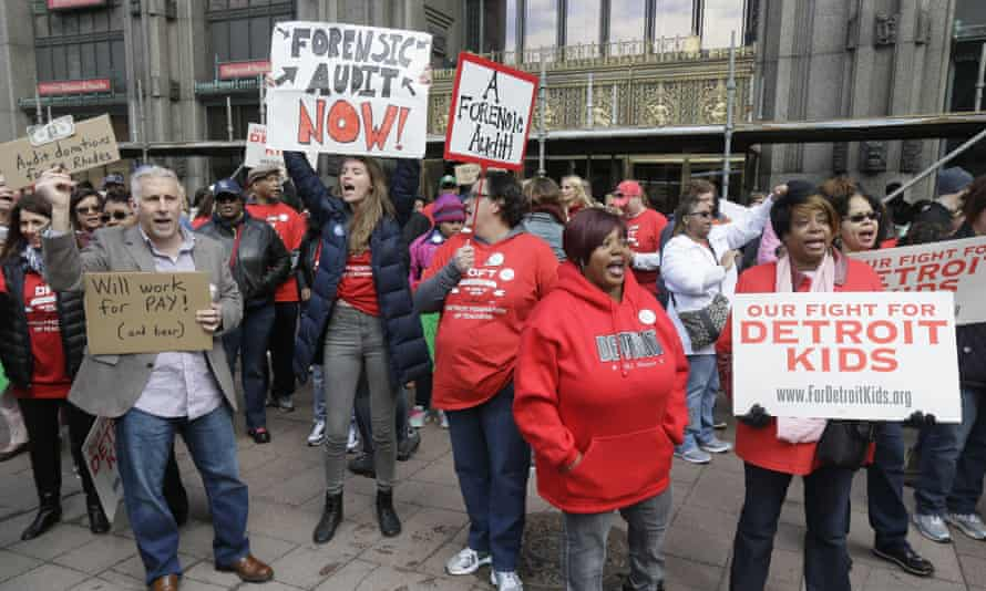 Teachers rally outside the Detroit school district's headquarters on 3 May 2016.
