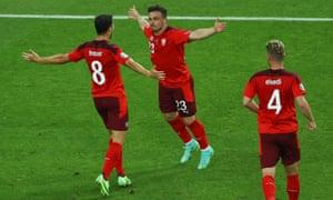 Xherdan Shaqiri (C) of Switzerland celebrates with team-mates after scoring.