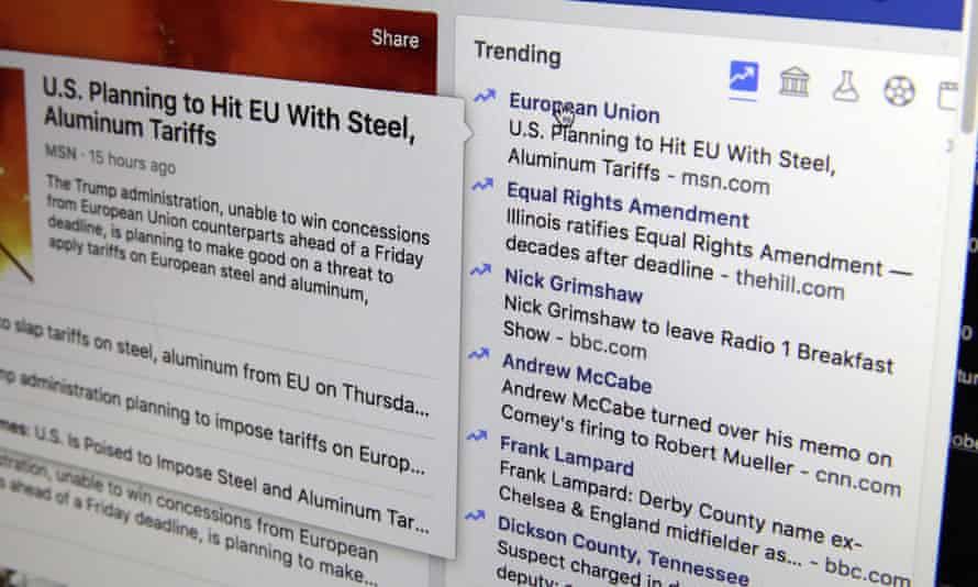 Facebook's trending news section displayed on a screen