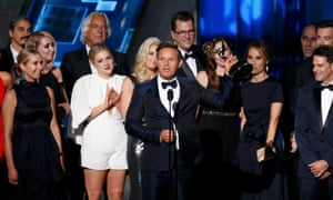 Mark Burnett accepts an award at the 2015 Emmys