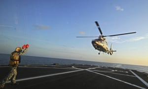 A Chinese military helicopter flies off the deck of Singaporean frigate during joint exercises in the South China Sea in May.
