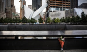 Flowers are laid at the 9/11 memorial site on 11 September 2015 in New York City.