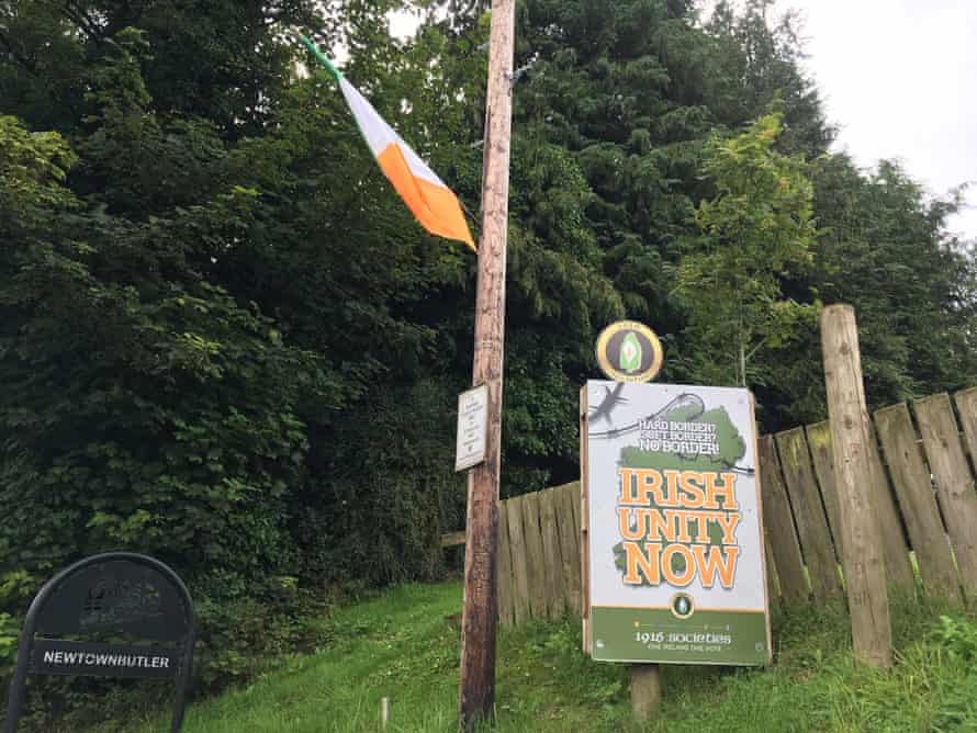 An Irish flag and sign promoting Irish unity at the entrance to Newtownbutler, Co Fermanagh.