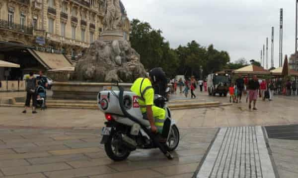 A motocrotte clears up after dogs on the streets of Montpellier.
