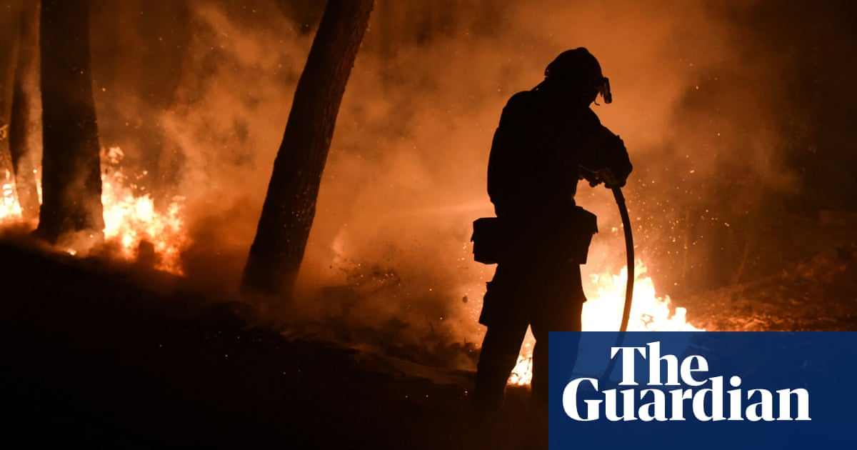 Greek firefighter killed and 20 injured as fires spread out of control