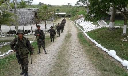 A handout photo released by Guatemala army shows Guatemalan soldiers patrolling in the Petén department, near the border with Belize on Thursday.
