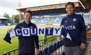 Connor and James Jennings pose with a Stockport scarf at Edgeley Park.