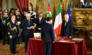 The new prime minister, Giuseppe Conte, stands in front of the president, Sergio Mattarella during the swearing-in ceremony in Rome.
