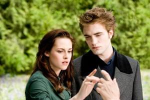 Pattinson as the vampire Edward, with Kristen Stewart, in The Twilight Saga: New Moon.