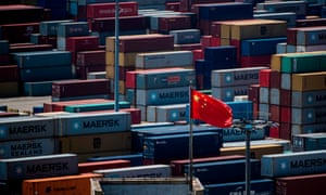 A Chinese flag in front of containers at the Yangshan deep-water port