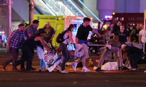 An injured person is tended to in the intersection of Tropicana Avenue and Las Vegas Boulevard.