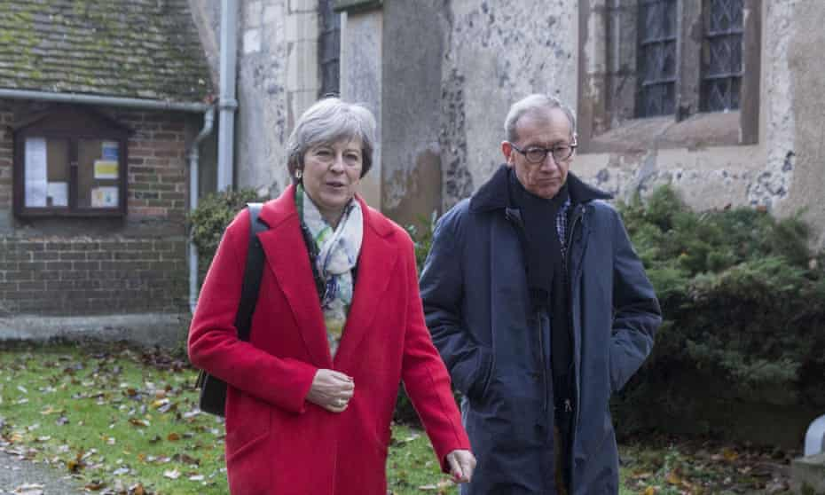 Theresa May leaves church with her husband Philip in Sonning, Berkshire on Sunday.