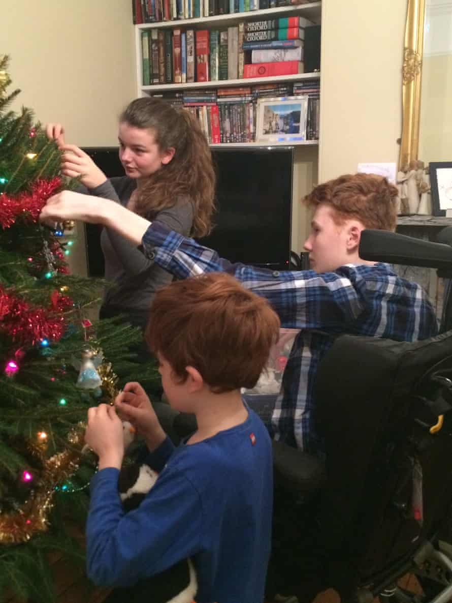 Max Edwards with his sister Esme, 14, and brother Toby, seven, decorating the Christmas tree in 2015