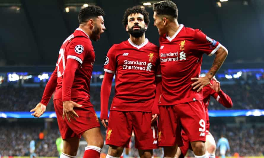 Alex Oxlade-Chamberlain (left) has helped unlock the attacking potential of Mo Salah and Roberto Firmino