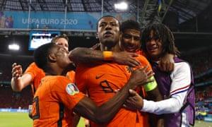 Georginio Wijnaldum (centre) of the Netherlands celebrates with teammates after opening the scoring.