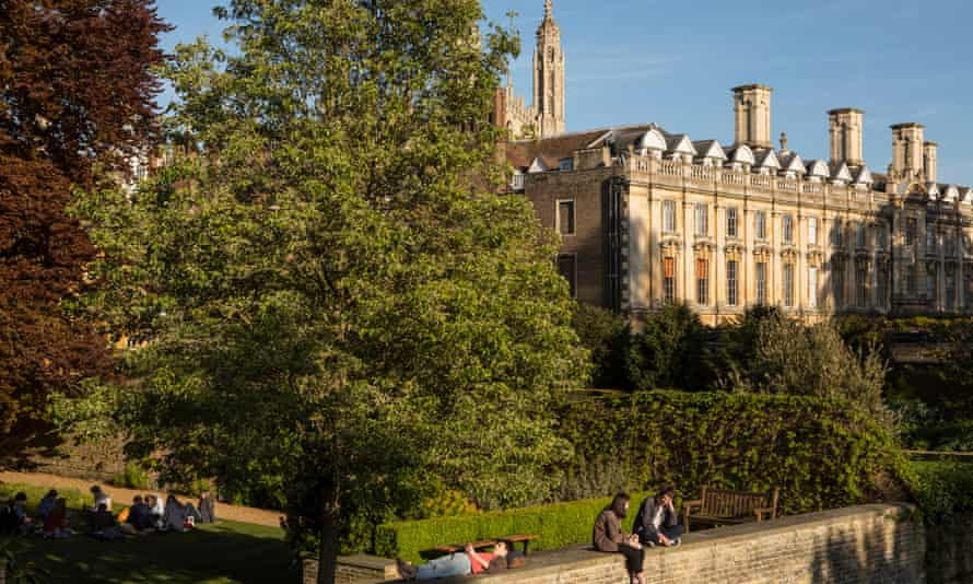 Students relax on the garden walls of Trinity Hall, Cambridge.