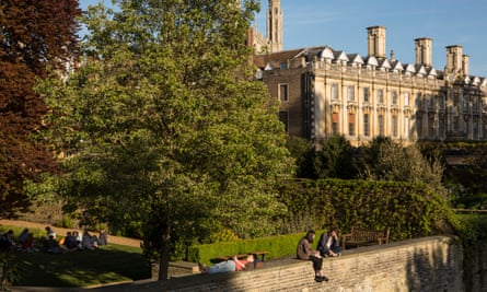 Students relax on the walls surrounding college buildings in Cambridge.