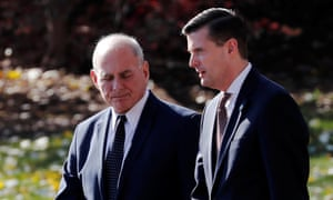 John Kelly walks with the then White House staff secretary Rob Porter in November 2017. Kelly allegedly knew of the domestic violence allegations against Porter last autumn.