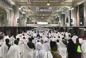Muslim pilgrims gather to circumambulate around the Kaaba, Islam's holiest site, located in the centre of the Masjid al-Haram mosque, Mecca, Saudi Arabia