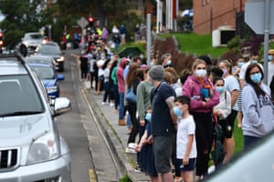 People queue for coronavirus testing in Wollongong, New South Wales, after a resident tested positive on Tuesday.
