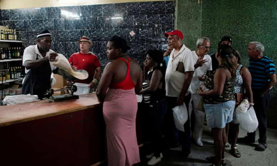 People wait in line to buy rice in a state store in downtown Havana.