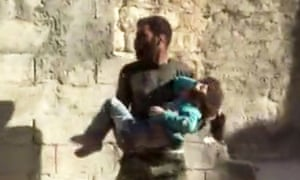 A girl is carried from the rubble after airstrikes in Aleppo.