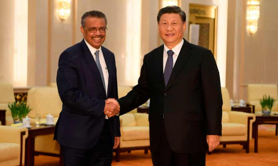 Xi Jinping greets the World Health Organization director general, Tedros Adhanom