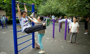 Elderly residents engage in early morning exercises in Beijing's Di Tan park in the Dongcheng area of the city
