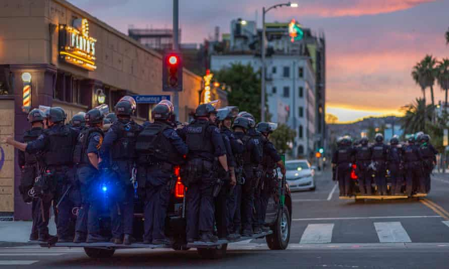 Police move through during demonstrations over the death of George Floyd on Monday in Hollywood.