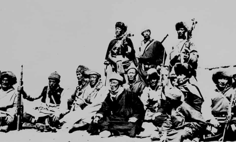 The Dalai Lama, sixth from left, rests with members of an escape party who protected him during his flight to exile across the Himalayas in March 1959.