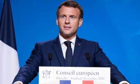 Emmanuel Macron standing at a podium