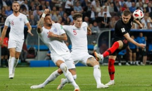 Kyle Walker (left) and John Stones try to crowd out a shot from Croatia's Ante Rebic.