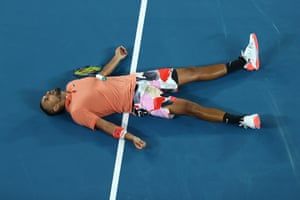 Kyrgios lays on the court after losing a point