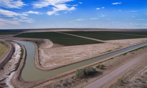 Irrigation canals and cotton fields