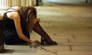 Woman drinker slumped on pavement