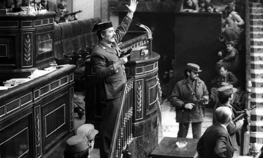 Lt Col Antonio Tejero, centre, arm raised, during an attempted coup in the Spanish parliament, 23 February 1981.
