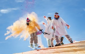 Skiers take part in the Skicolor event where they are sprayed with biodegradable coloured powders as part of carnival celebrations in La Tzoumaz, Switzerland